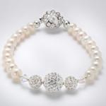 Freshwater pearls and swarovski crystal bracelet . Crystal clasp