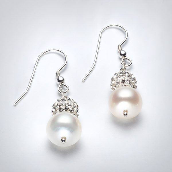 Freshwater pearls and swarovski crystal Earrings .