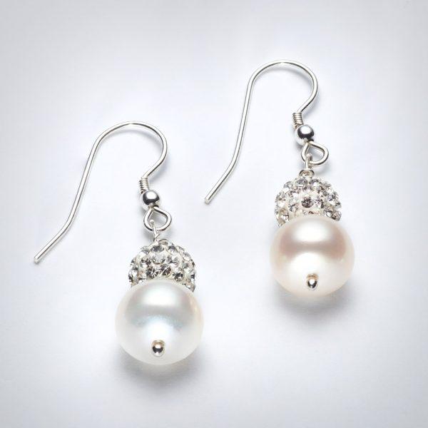 Freshwater pearls and swarovski crystal Earrings .