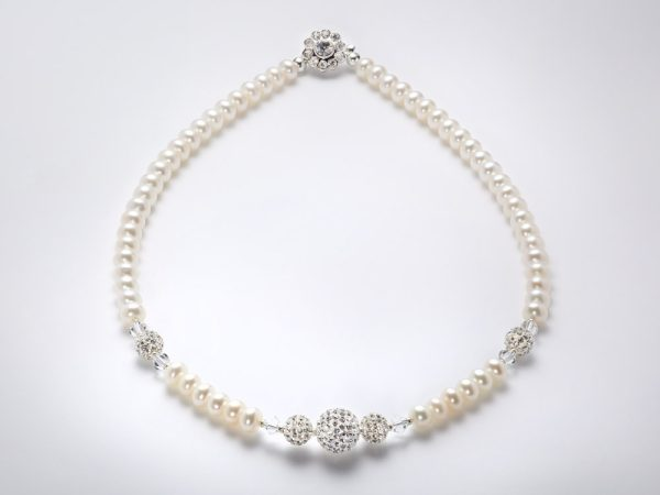 Freshwater pearls and swarovski crystal Necklace . Crystal clasp
