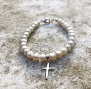 Small pearl and silver cross child's bracelet