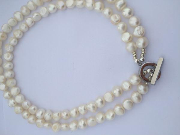 Freshwater pearls hand made in cork